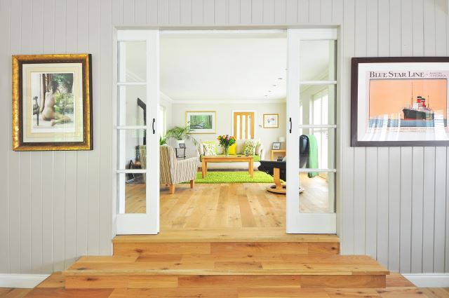 A fresh home in light timber flooring with white doors and fresh light green decorating touches