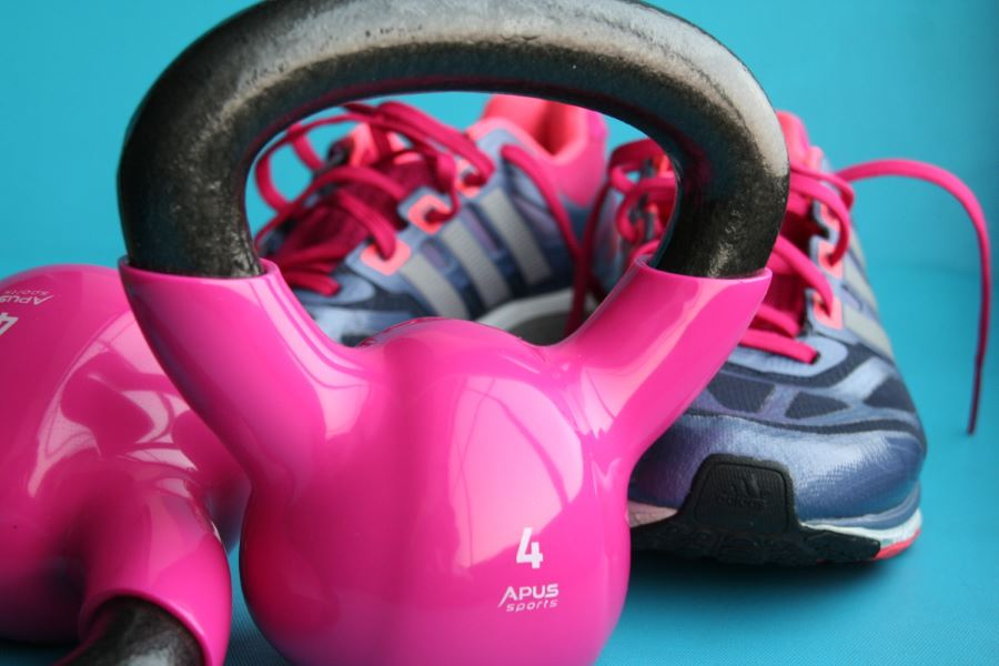 exercise for fitness with a pink kettle bell