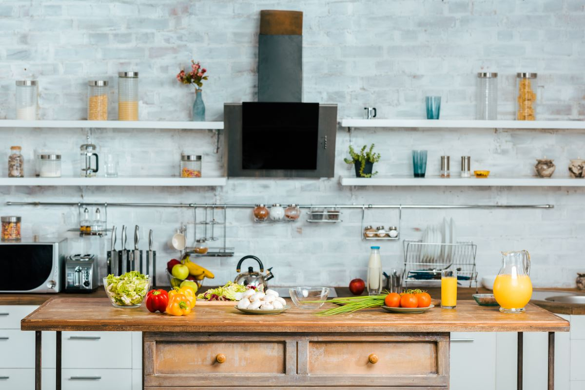 Contemporary kitchen with raw foods cut up on the kitchen island table