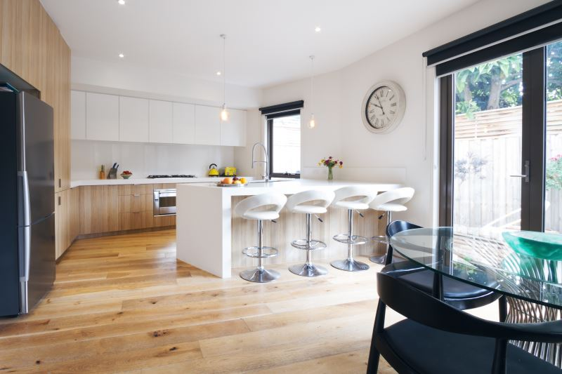 Modern open plan kitchen with island bench and bar stools