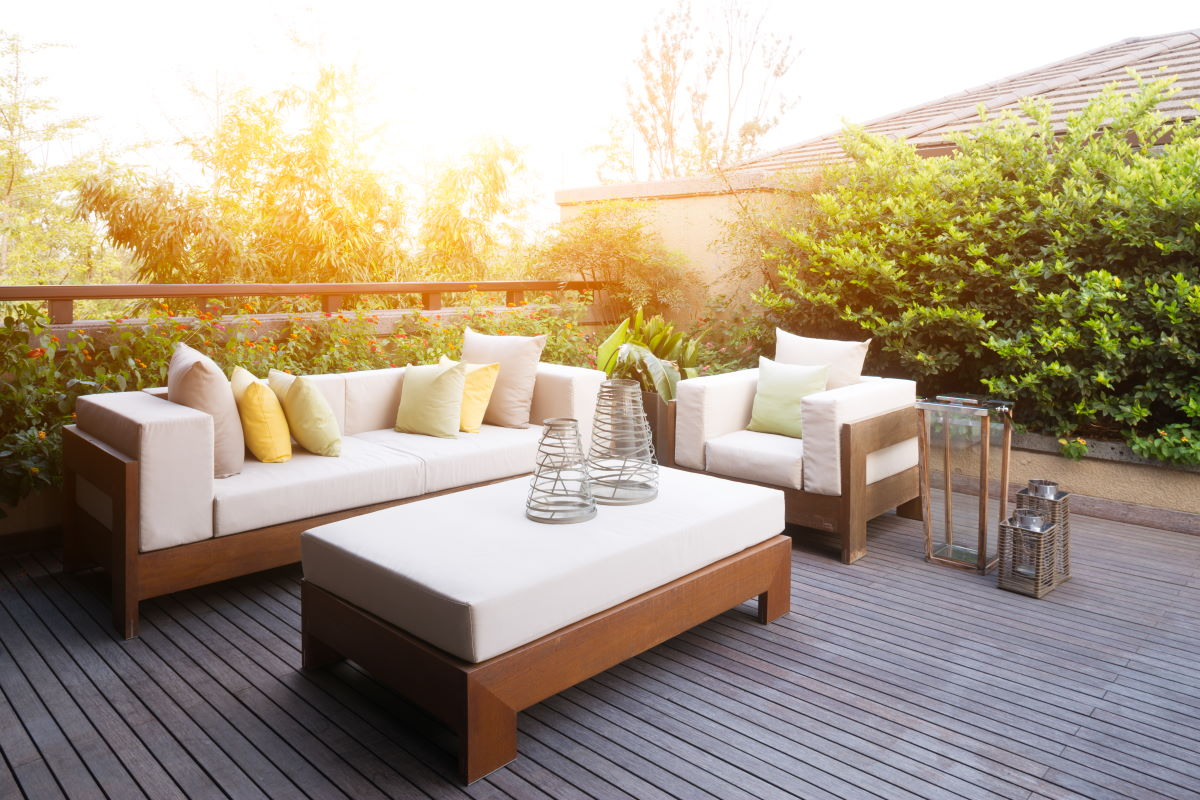 Decorated deck with furniture at sunset